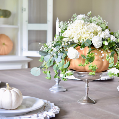 Dining room fall decor with pumpkins & florals
